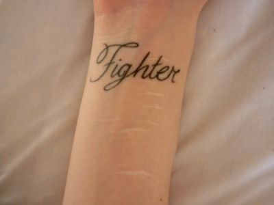 I've heard people complain about wrist tattoos. How only people who cut themselves would get them, and though that's not true, so what? If that's what's going to get you through, then go for it! If that reminder keeps you from cutting again, who cares what everyone else thinks. You're a fighter. Whatever it takes, fight on. You're worth it. You deserve to live. Please keep fighting.