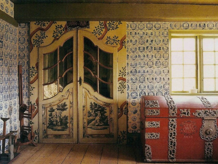 Delft Tiles imported by Dutch whaling vessels enrich the walls of a captain's 18th century farmstead in Rømø, Denmark; photographed for World of Interiors.