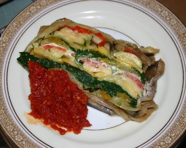 ... roasted vegetable & goat cheese terrine with sun-dried tomato sauce
