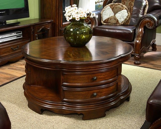 round coffee table with drawers and open shelves