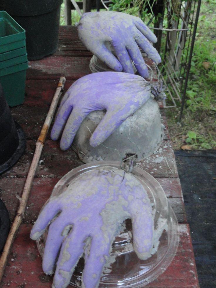 Cement hands made from rubber gloves and cement... Want to and Could try spray foam as well