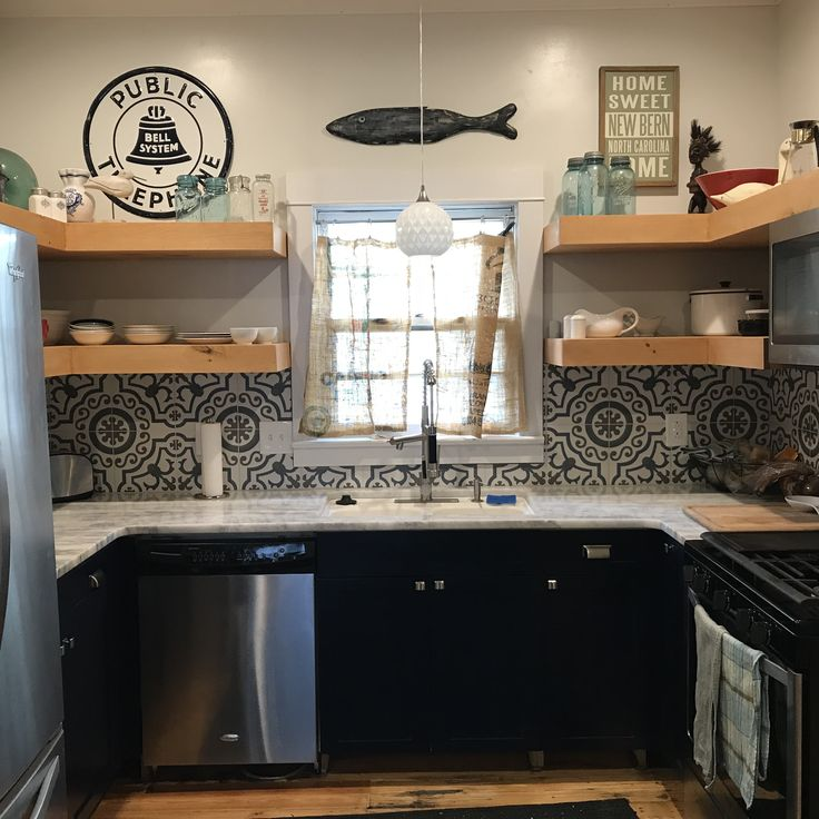small kitchen reno. marble counters, open shelving, large format tile backsplash