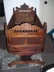 Baby Cradle dated 1870 it looks like an  Eastlake work.