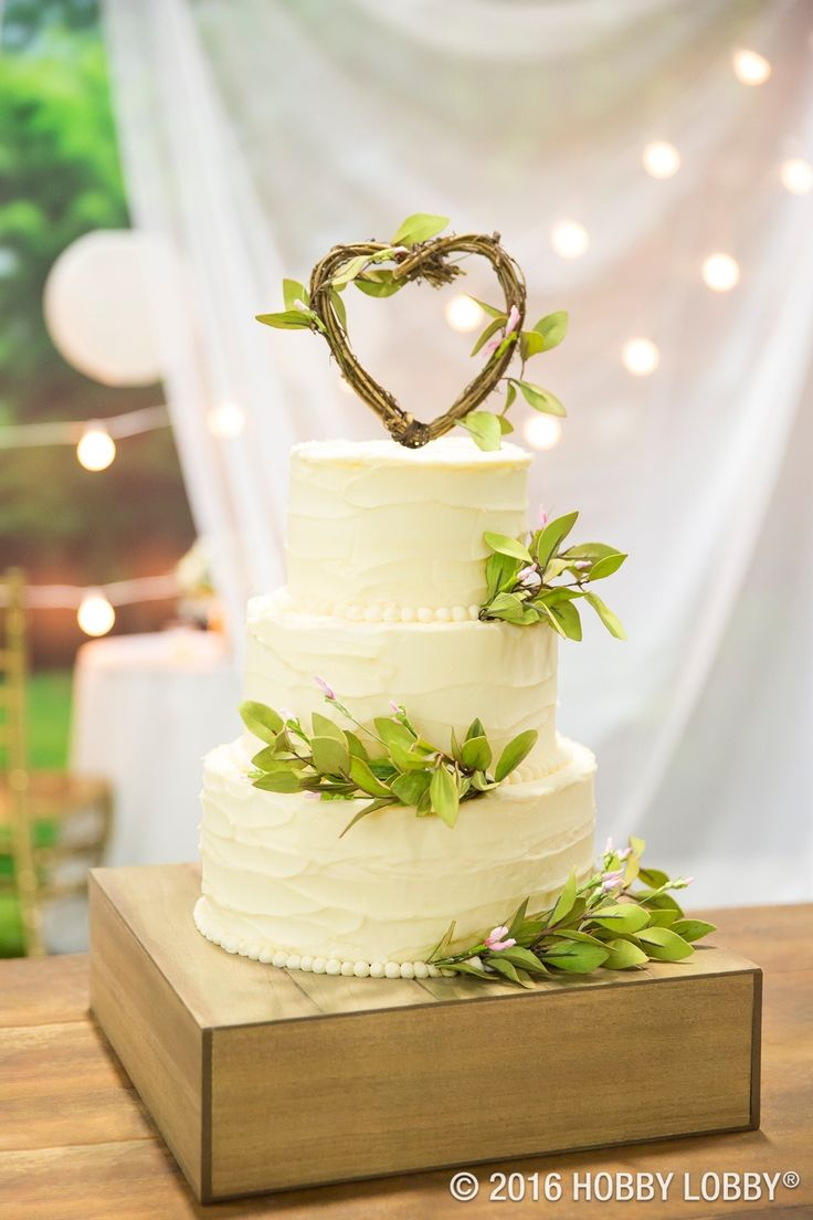 from hobby lobby tea leaves and a grapevine topper make for a cake thats as charming as it is