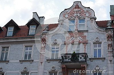 Detail of a tenement, an urban residential brick building standing in a tight range of other houses and distinguished by the absence of large windows. This building is in Katowice, Poland and represent its typical architecture found throughout the city.