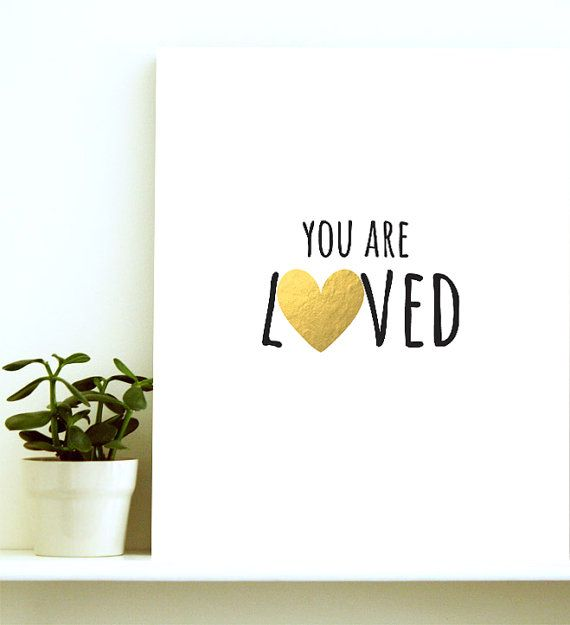 The you are loved typographic print has the sweetest look to it-complete with hugging letters and a golden heart. Put it up in the nursery, a kids
