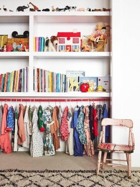 kids room design - storing kids dress up clothes and toys - kids bookshelf with vintage toys