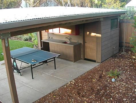 Shed, sink and a place for the table tennis to get it out of the basement! =)