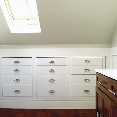 Prefab drawer units with MDF interiors were built into the eaves of this attic bathroom to gain valuable storage space.  | Photo: David Prince | thisoldhouse.com