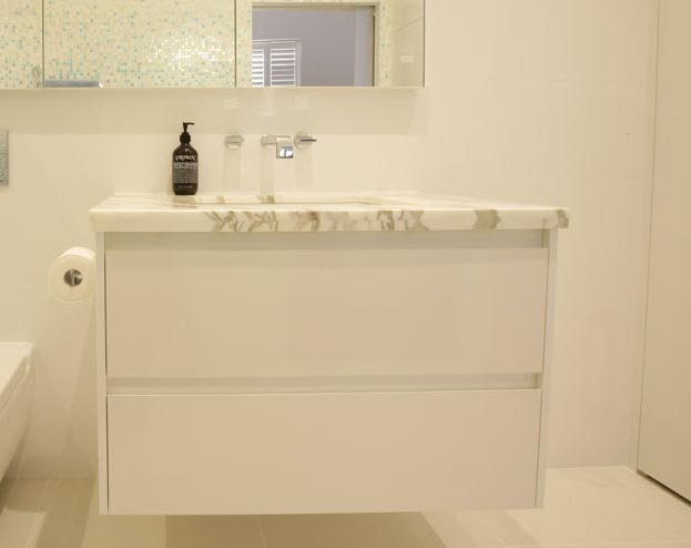 Smarter Bathrooms designer vanity with custom drawers and marble benchtop in Melbourne bathroom.