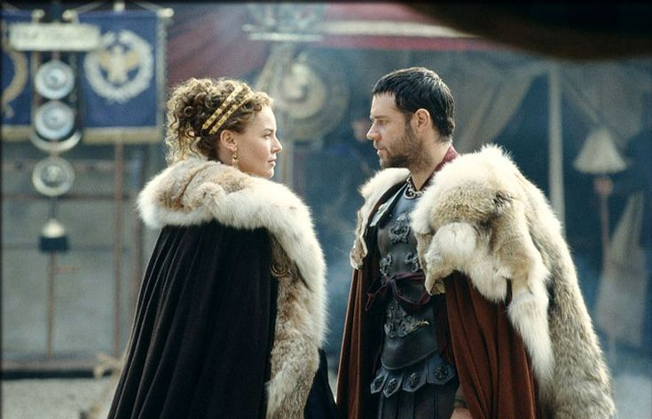 Lucilla's amazing cloak, jewels, Roman hairstyle, love it all.