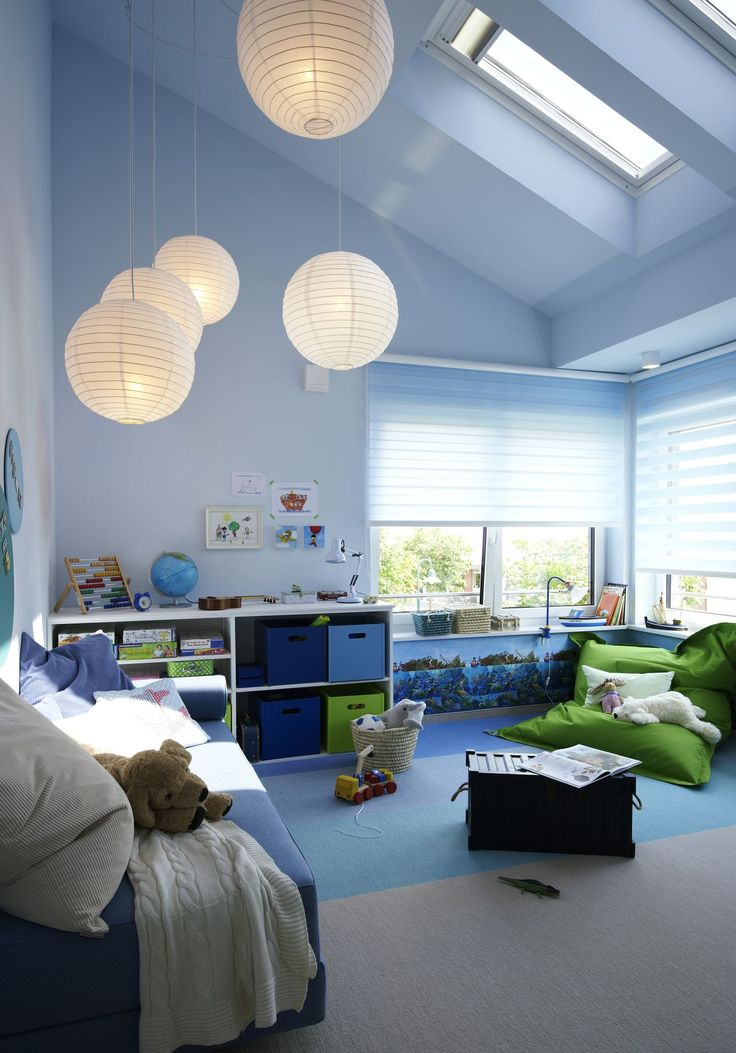 I like this Boy's Room because there are many windows and lamps. Also one has enough space to play, relax and to pack sty away. Furthermore I like that there are some vbut not too many details confirming the decoration.