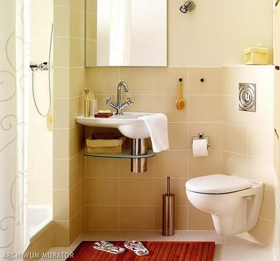 toilet attached to wall and small shelf under sink