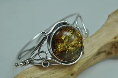 Unique amber bangle, bracelet with greenish beutiful amber stone in ornate sterling silver mount.