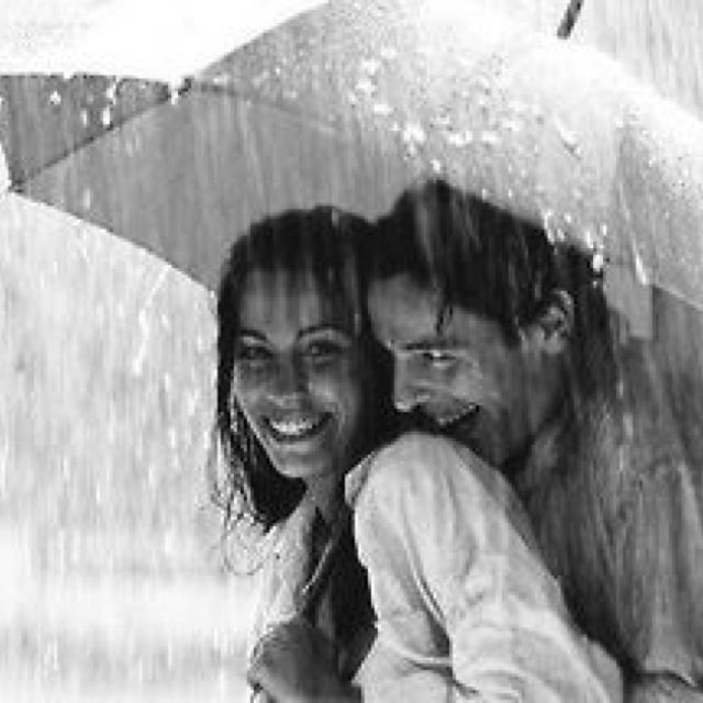 Couple in the rain. Cute! But he looks slightly creepy..