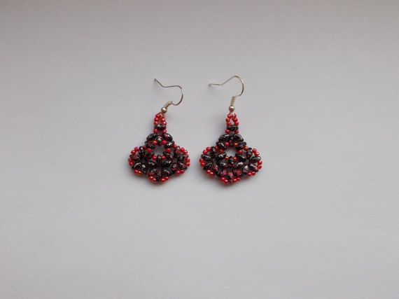 Check out this item in my Etsy shop https://www.etsy.com/listing/494412750/red-and-black-fan-earrings