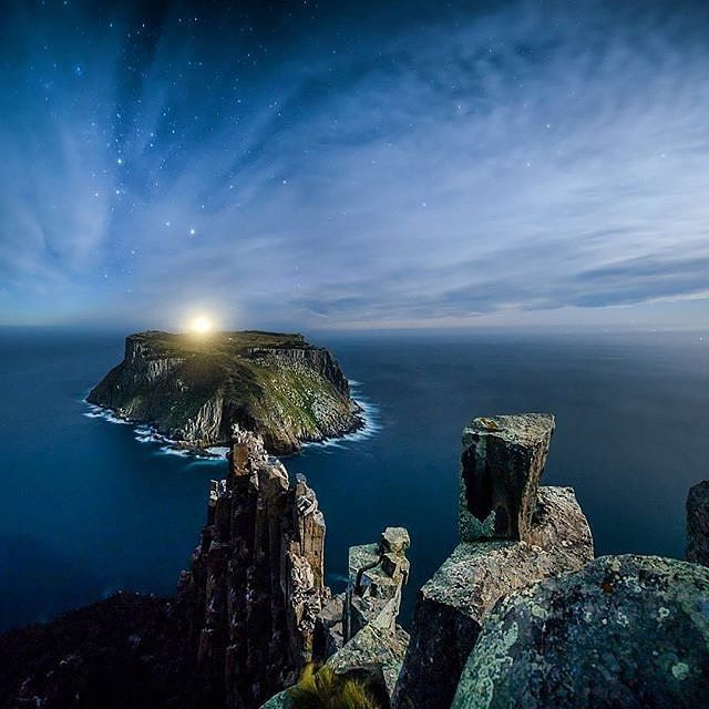 "The quiet, midnight views of Tasman Island captured from the sheer dolerite columns of Cape Pillar. @ffourie snapped this shot while in the coastal reaches of the Tasman National Park and it was recently named the overall winner of this year's Tasmanian Night Sky Photography Awards. 'I hiked along the Three Capes Track for 16km before I got to a good spot to shoot. Then I had to stand near the edge of a cliff in extreme wind and darkness to capture the photograph,"" he said. We think it was…"