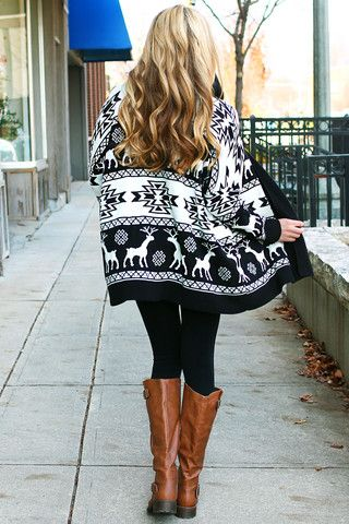 Fall / Winter - street style - cozy style - black and white oversized holiday reindeer sweater + black leggins + brown riding boots
