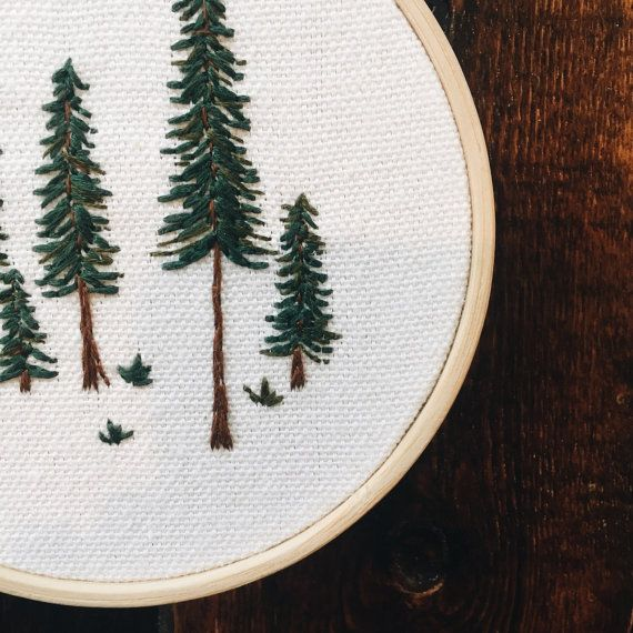 Pine Tree Embroidery Hoop  This is a 4 wooden hoop with hand a embroidered pine tree design. This piece is set in a wooden embroidery hoop frame and can easily be hung up or set out on display. Great to give as a housewarming gift or Christmas present. Note: Each item is hand-stiched by me and may slightly vary from the photos above! Every item is unique and one of a kind :)