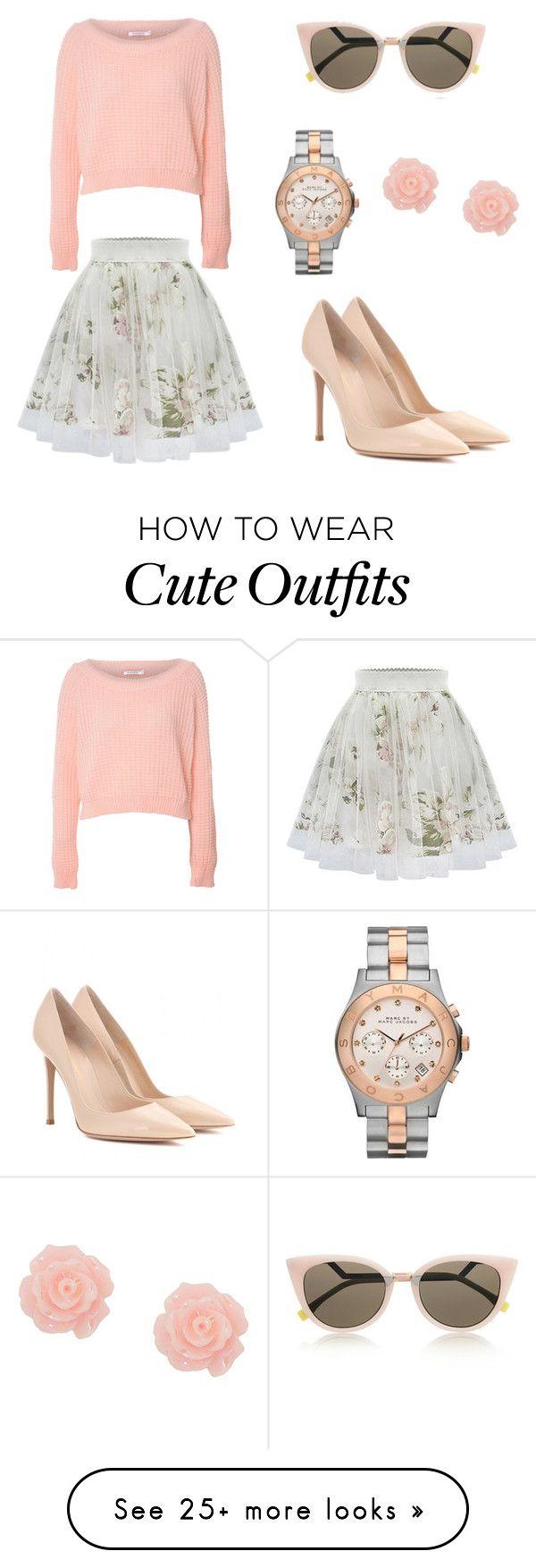 Falda de gasa caída blanca con estampado de flores verde, chaleco corto de lana rosa palo y tacones rosa palo.