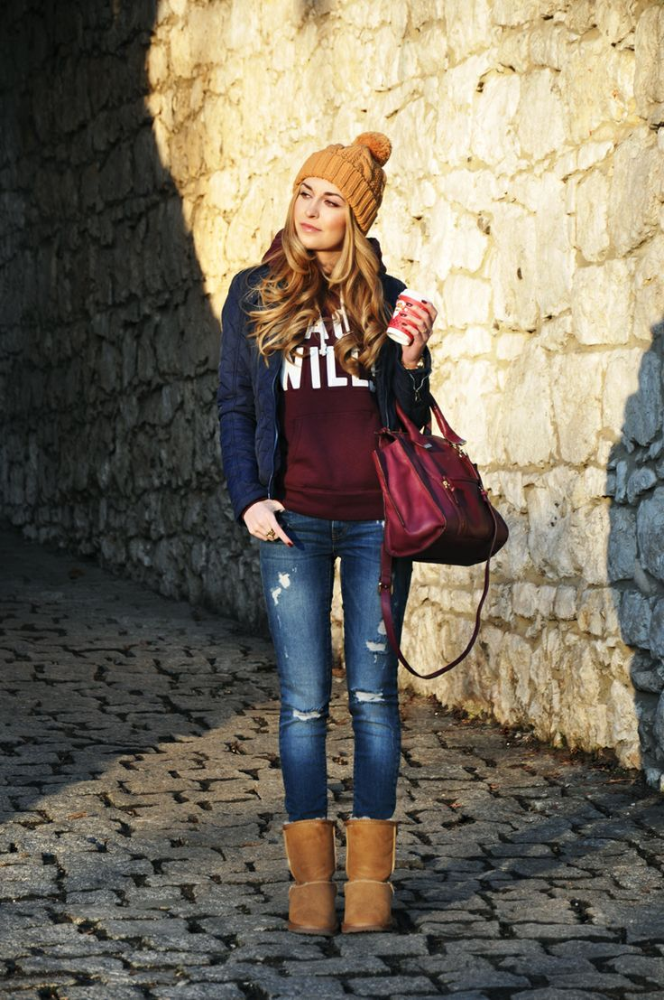 Team a dark blue quilted jacket with blue distressed slim jeans for a Sunday lunch with friends. Brown uggs will add a new dimension to an otherwise classic look.  Shop this look for $211:  http://lookastic.com/women/looks/beanie-jacket-hoodie-satchel-bag-skinny-jeans-uggs/7075  — Tan Beanie  — Navy Quilted Jacket  — Burgundy Print Hoodie  — Burgundy Leather Satchel Bag  — Blue Ripped Skinny Jeans  — Brown Uggs