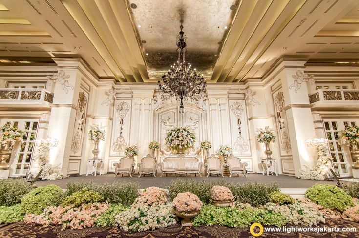 The elegant wedding stage at Kempinski Hotel Jakarta. Decoration by Lotus Design and lighting by Lightworks