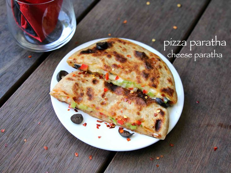 pizza paratha recipe, cheese paratha recipe, cheese stuffed paratha with step by step photo/video. interesting fusion recipe with veg pizza recipe