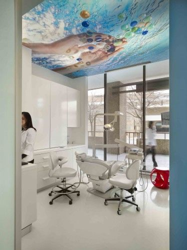Awesome photo praphics on the ceiling - Smile Designer Dental Office Interiors / Antonio Sofan Architect LEED AP