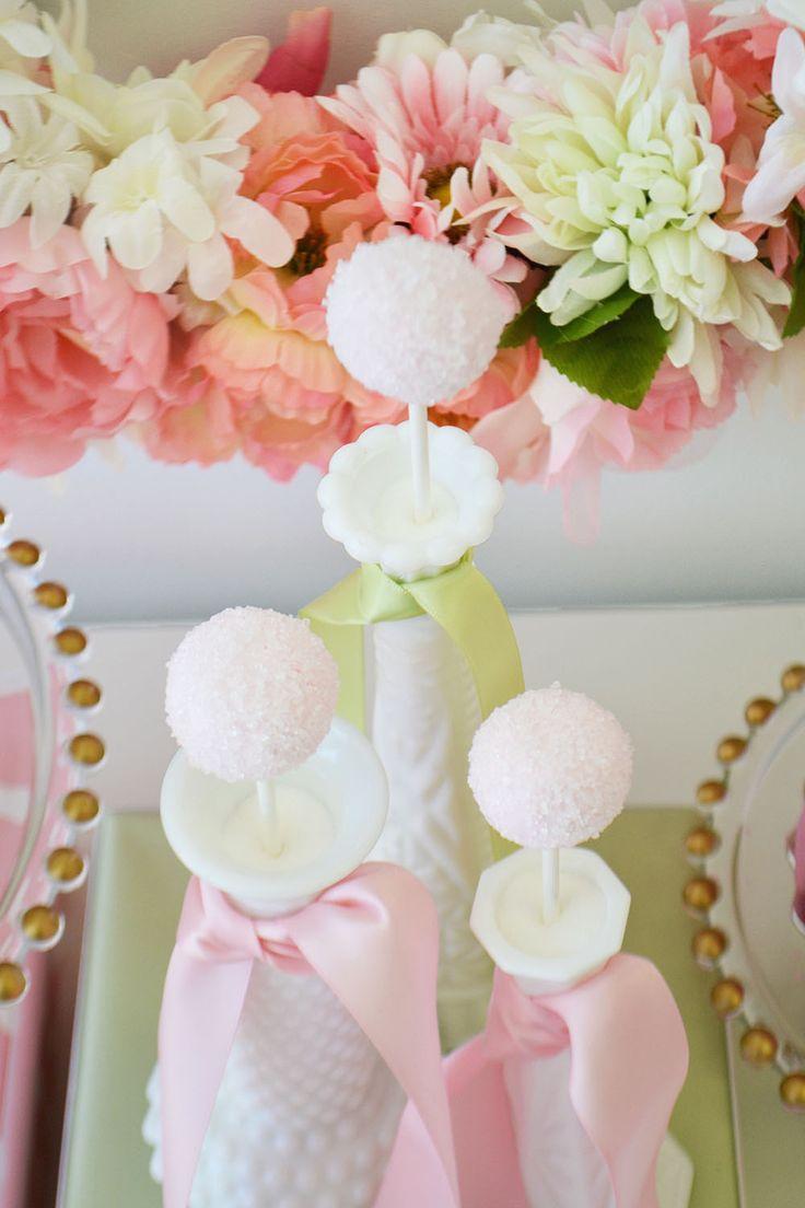 Milk glass vases make great holders for cake pops at a vintage baby shower. By Bake Sale Toronto.