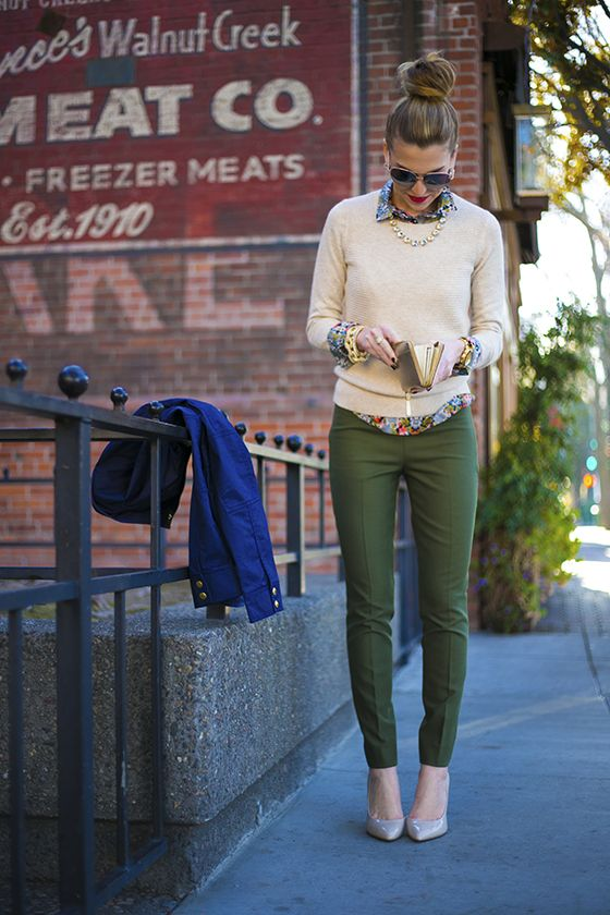 Hunter green pants, floral shirt and neutral sweater.