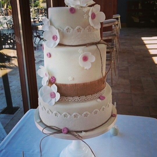 Vintage wedding cake with lace detail, buttons and hessian, set up at The Corran resort Laurghne