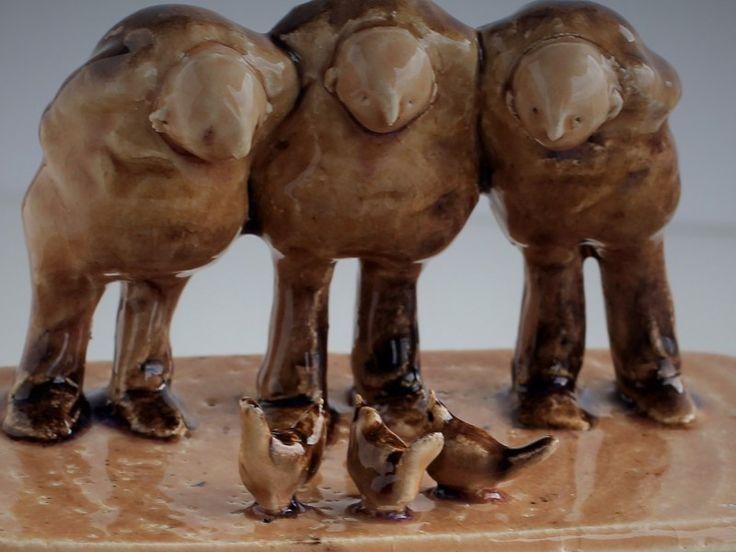 "Ceramic sculpture, ""Three men with birds"". Stoneware clay."