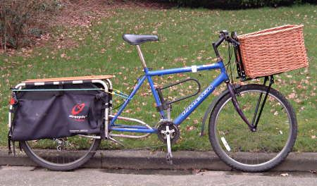 David Hembrow Basketmaker - All about attaching baskets / containers to front or back of your bicycle.  Tells you all about types of racks & pro's & con's of each type.  Hembrow mades handmade willow baskets for anything - custom, bicycle, panniers, BOB Yak trailer. . .