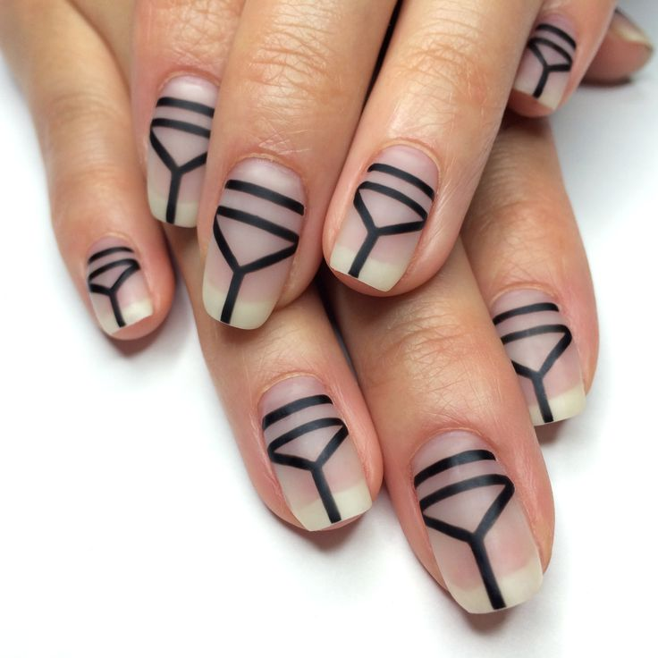 Matte black geometric nail art