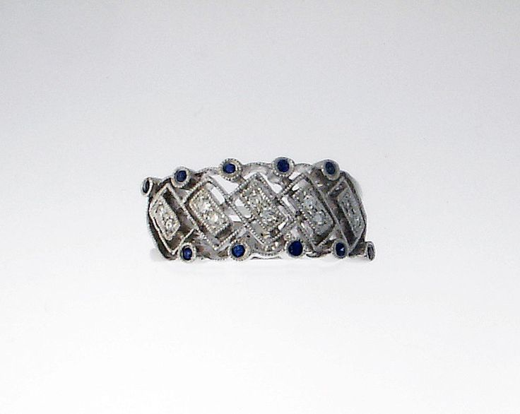 unique 14k white gold, diamond and sapphire ring.  Comment or email jeff@premiergems.ca for details. -SOLD-