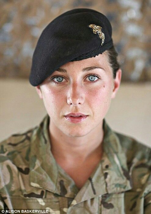The very same lady. Beautiful eyes and an Irish military beret.