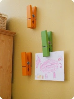Cute way to display artwork.  You can get the giant clips at Hobby Lobby or Michaels.