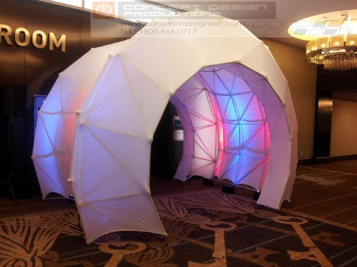 A 15' Diameter tunnel or entryway created with Space Rings and Space Arch covered with stretch fabric for exterior or interior lighting and projection. The tunnel may be any length from 10' to 150' long !