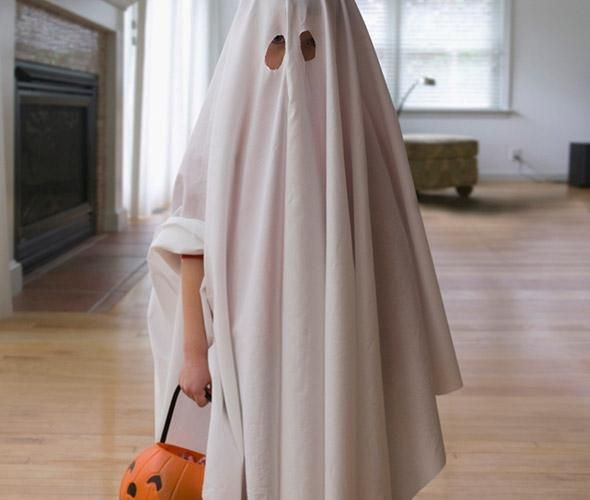 Ghost: The ghost costume requires a white sheet and scissors. Cut out holes for your eyes. Done.