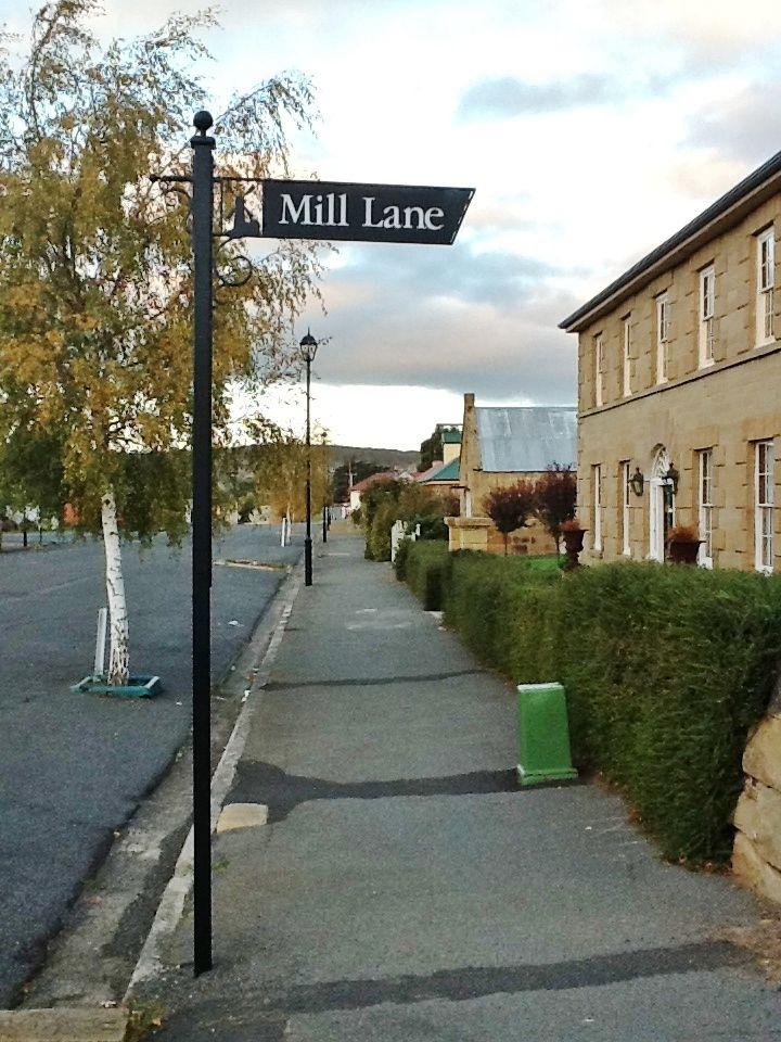 Mill Lane sign and sandstone buildings, Oatlands, Tasmania