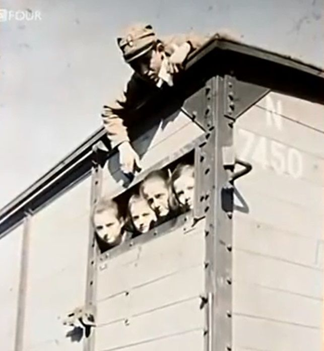 You could be easily mistaken in thinking this photo is from the deportation of Jews to a concentration camp. In fact it's a photo taken during the #GreekGenocide. It shows an old woman and 3 children peering out of a train carriage while a soldier lies on the roof above them. They are Christians, seeking urgent passage out of Turkey following the burning of Smyrna. Photo: Albert Kahn archive