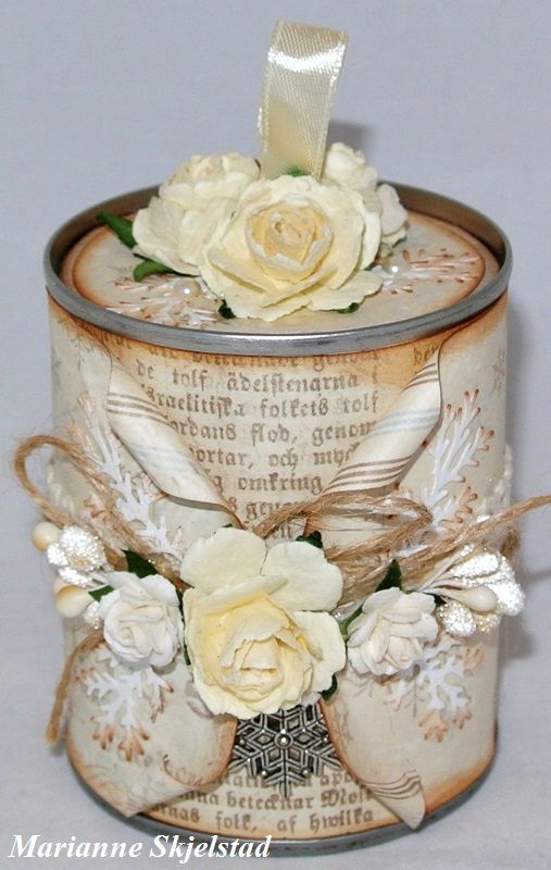 Tin cans can be used for so many different projects. This corn can is now decorated with with papers from Silent Night together with roses, ribbons, berries and pearls. I have also made a lid for the can to make it even more decorative./Marianne