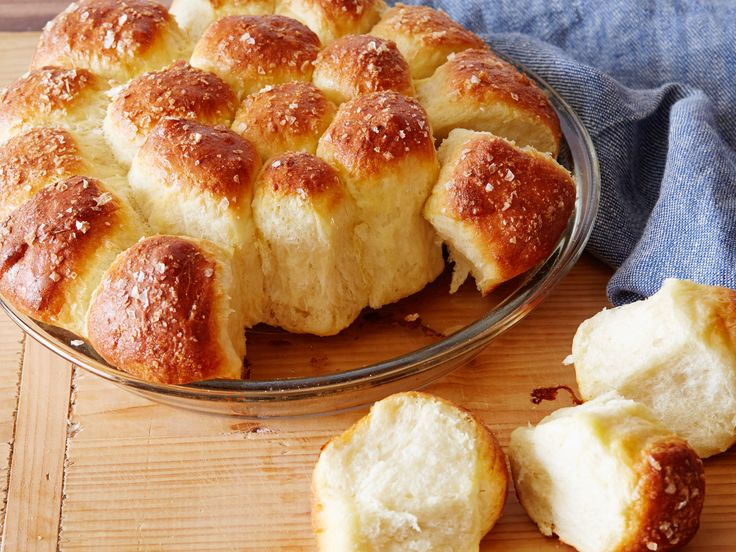 Parker House Rolls : Since their fabled start at Boston's Parker House Hotel in the late 1800s, Parker House Rolls rolls have been a (frequently reproduced) dinnertime breadbasket staple. The soft, buttery rolls have a crispy, browned, egg-washed exterior and large flakes of kosher salt that nicely offset the bread's sweetness. via Food Network
