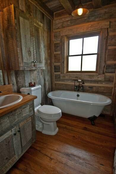 Barnwood. ... there's always something  I would tweek to my own likin' ... I don't care much for the commode in the center 'n not a big fan of white in a rustic bathroom ... but I always LOVE barnwood <3