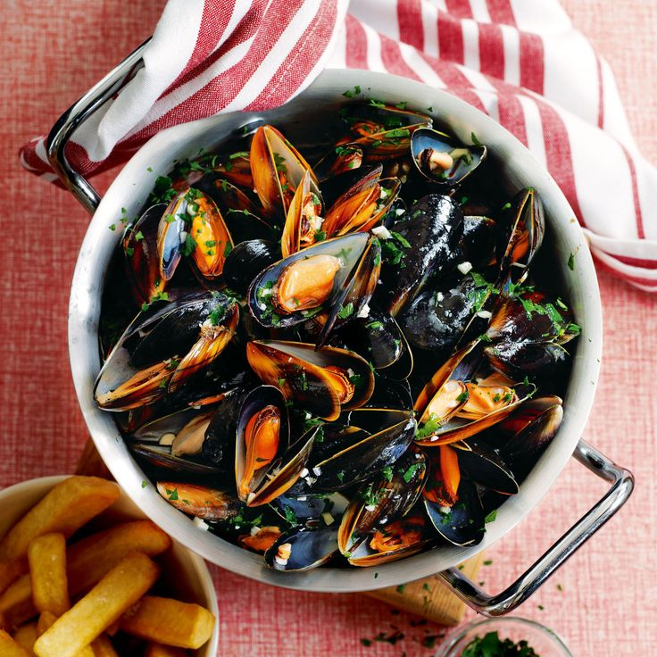 A mountain of mussels in a creamy white wine and parsley sauce, that's perfect for dipping in home-cooked chips