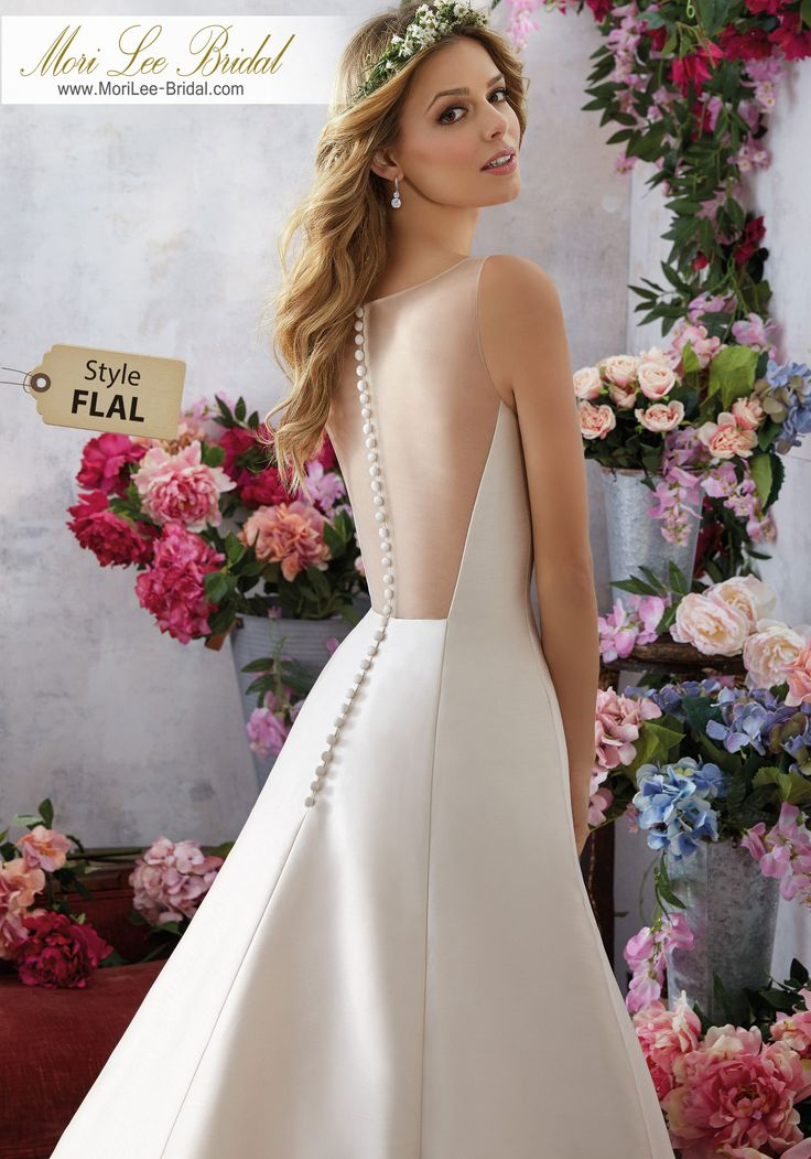 Style FLAL Melody Wedding Dress  A Classicially Elegant A-Line Comes to Life in This Dupioni Wedding Gown. The Illusion Net Back is Accented with Covered Button Detail. Colors Available: White, Ivory, Light Gold. Shown in Light Gold.