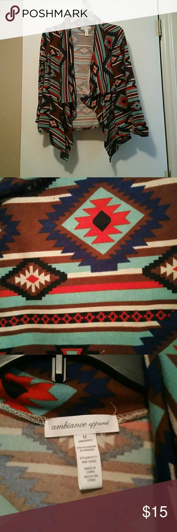NWOT Tribal Print Cardigan Tribal print cardigan size medium. Can fit a small loosely and medium perfect. New with out tags never worn besides to try on at store. Comes from a smoke free home and willing to take offers just no low blow offers! Ambiance Apparel Sweaters Cardigans