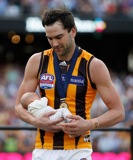 2015 Toyota AFL Grand Final - Hawthorn v West Coast - Jordan Lewis of the Hawks receives his premiership medal with his baby boy after winning the 2015 Toyota AFL Grand Final