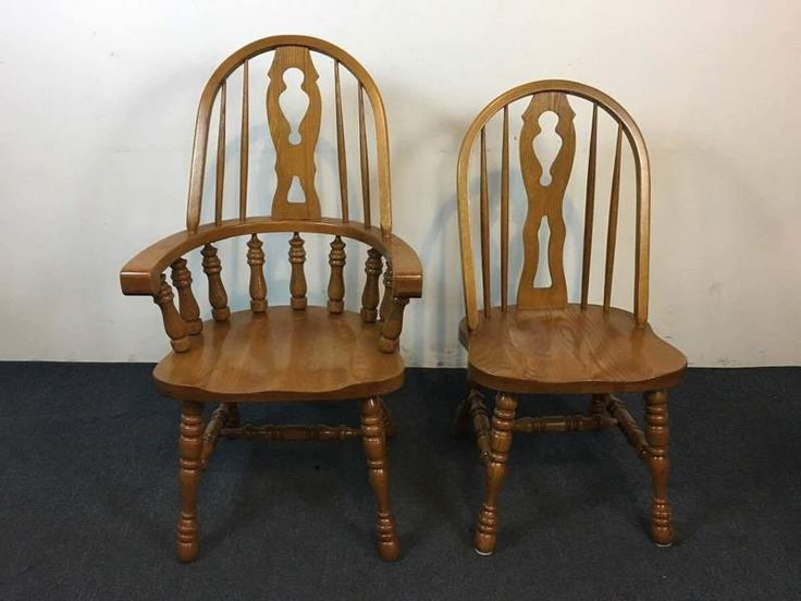 Lincolnton North Carolina Carved Oak Dining Chairs, comprised of two king seats and four side chairs, bearing spindle backs
