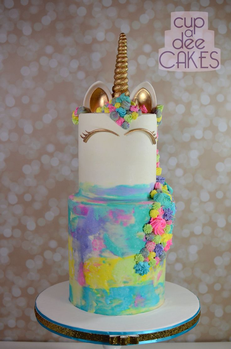 Two Tier Unicorn Cake With A Baby Cake And Cupcake